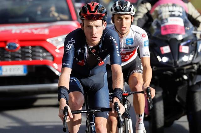 Team Ineos rider Tao Geoghegan Hart, left, and Team Sunweb's Jai Hindley ride uphill at Passo dello Stelvio during the 18th stage of the Giro d'Italia 2020.