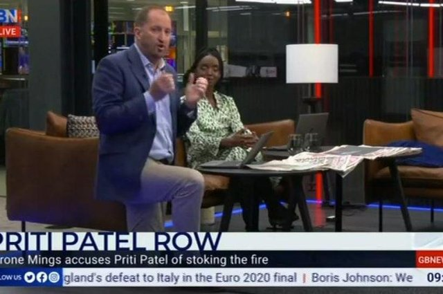 """GB News said its presenter GutoHarri breached its """"standards"""" by taking the knee on air in support of England's footballers."""