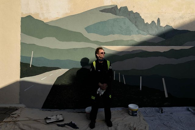 Donnie Munro with his mural of The Storr in Portree. PIC: Gavin Major.