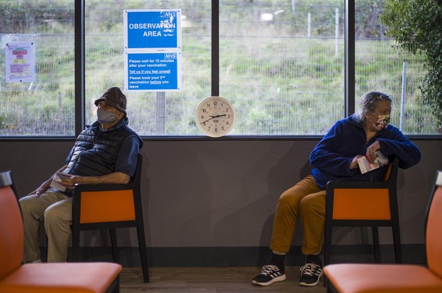 Patients sit in the observation area after receiving a Covid-19 vaccine from their GP. Picture: PA.