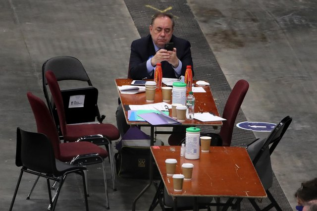 Alba Party leader Alex Salmond on his phone as votes are being counted for the Scottish Parliamentary Elections at the P&J Live/TECA, Aberdeen. PIC: PA.