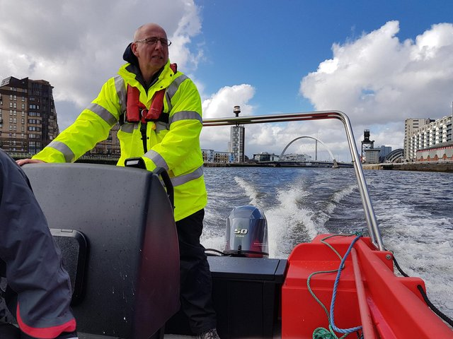 Gordon Goldie at the helm of the Glasgow Humane Society's new boat. (Picture: GHS)
