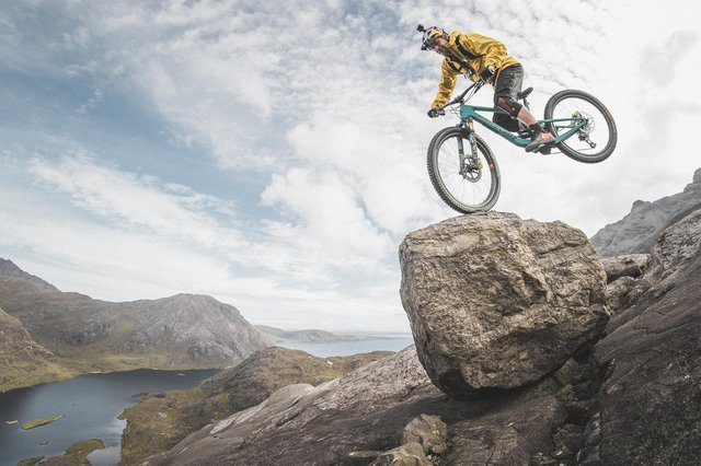Danny MacAskill cycles down a moderate rock climb known as The Slabs on Skye