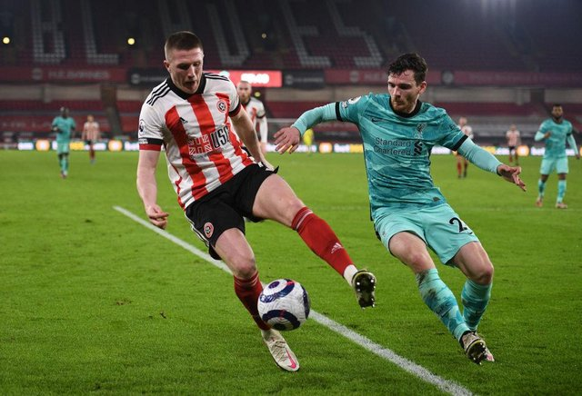 John Lundstram being closed down by Scotland captain Andy Robertson in a match between Sheffield United and Liverpool. Picture: Getty