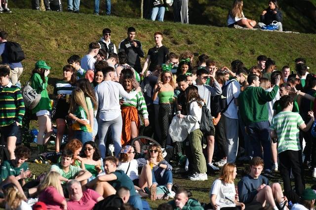People congregate to celebrate St Patrick's Day in Kelvingrove Park in Glasgow.