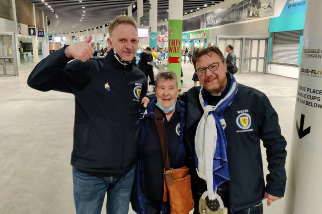 Moira Brown (centre) with fellow Scotland fans Alistair Firth and James Lall