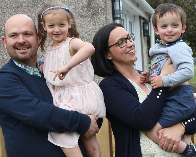 Kenny and Crystal Arnott with three-year-old Benjamin and his big sister, Lily, five in their garden Penicuik.