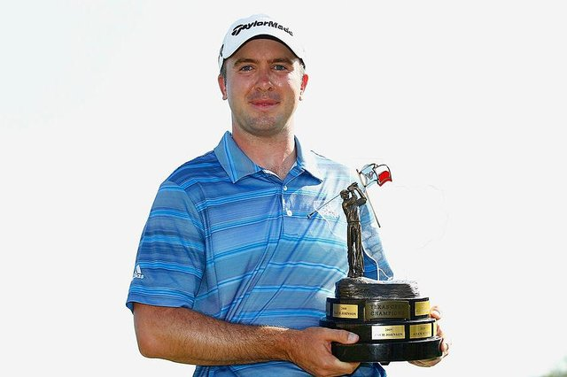 Martin Laird holds the trophy after winning the 2013 Valero Texas Open at TPC San Antonio. Picture: Michael Cohen/Getty Images.