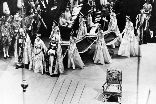 Queen Elizabeth II walks to the altar during her coronation ceremony on 2 June, 1953 in Westminster Abbey. PIC: AFP via Getty Images
