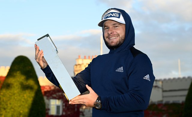 Tyrrell Hatton wearing his hoodie and holding the winners trophy at the BMW PGA Championship at Wentworth at the weekend. Picture: Ross Kinnaird/Getty Images