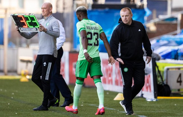 Neil Lennon shakes hands with Boli Bolingoli prior to the full-back's appearance against Kilmarnock. Picture: SNS