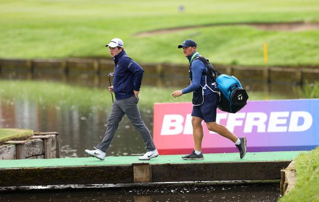 Bob MacIntyre and caddie Mikey Thomson walk to the 10th green during the first round of The Betfred British Masters hosted by Danny Willett at The Belfry. Picture: Richard Heathcote/Getty Images.