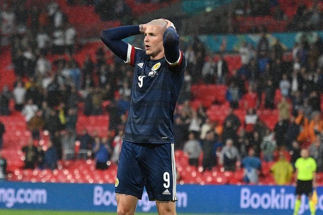 Scotland's Lyndon Dykes reacts to a missed chance during the 0-0 draw with England at Wembley (Photo by JUSTIN TALLIS/POOL/AFP via Getty Images)