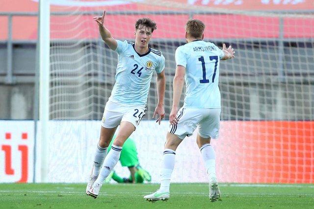 Jack Hendry of Scotland celebrates with Stuart Armstrong after scoring their side's first goal during the international friendly match between Netherlands and Scotland at Estadio Algarve on June 02, 2021 in Faro, Portugal. (Photo by Fran Santiago/Getty Images)