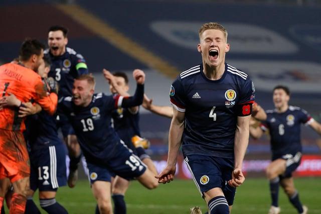 Scott McTominay celebrates at full-time against Serbia.