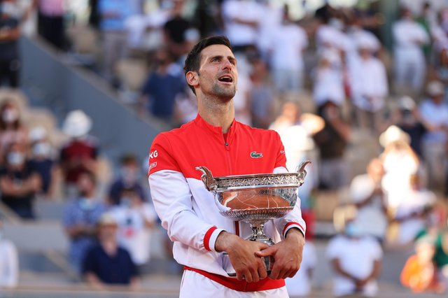 Novak Djokovic celebrates as he holds the trophy after winning the French Open final against Stefanos Tsitsipas at Roland Garros. (Photo by Clive Brunskill/Getty Images)