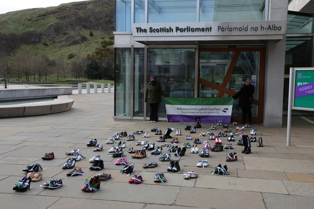 An installation of women's shoes outside the Scottish Parliament by a new feminist group aims to highlight women's issues to the political parties. (Picture: Sole Sisters)