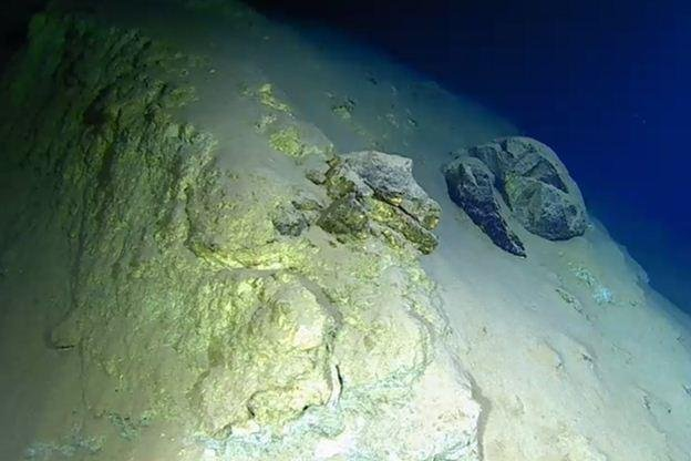 """Deep-diving geologist Heather Stewart said: """"There is something a little bit selfish about seeing something nobody's ever seen before. The colours are amazing - oranges, luminous yellows, bright blues - in the rock wall, picking out all the fractures."""""""