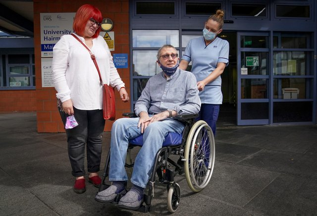 Neil McLaughlin, with partner Wendy Busby (left), leaves the University Hospital Hairmyres, East Kilbride, after being discharged.