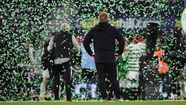 Neil Lennon soaks up the celebrations following Celtic's Scottish Cup final shoot-out success. They came at the end of  a fraught afternoon and allowed the team and their manager to claim historic places in Scottish football's record books with a quadruple treble that ensured the Irishman is the first man to claim a treble both a s player and manager. (Photo by Craig Foy / SNS Group)