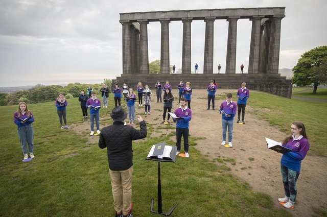 The National Youth Choir of Scotland, with founder and conductor Christopher Bell, meet on Edinburgh's Calton Hill to sing together for the first time since March 2020 (Picture: Jane Barlow/PA Wire)