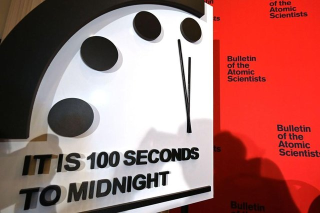 The Doomsday Clock reads 100 seconds to midnight for the second year running, 'the closest to Doomsday we have ever been' (Photo: EVA HAMBACH/AFP via Getty Images)