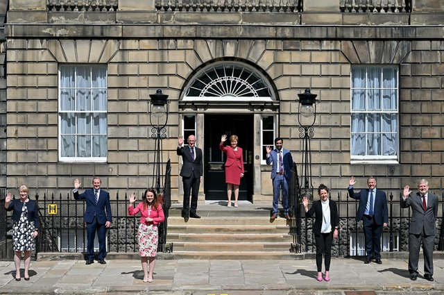 Waving, not drowning... the refreshed Scottish Cabinet greets a new era (Picture: Jeff J Mitchell/Getty)