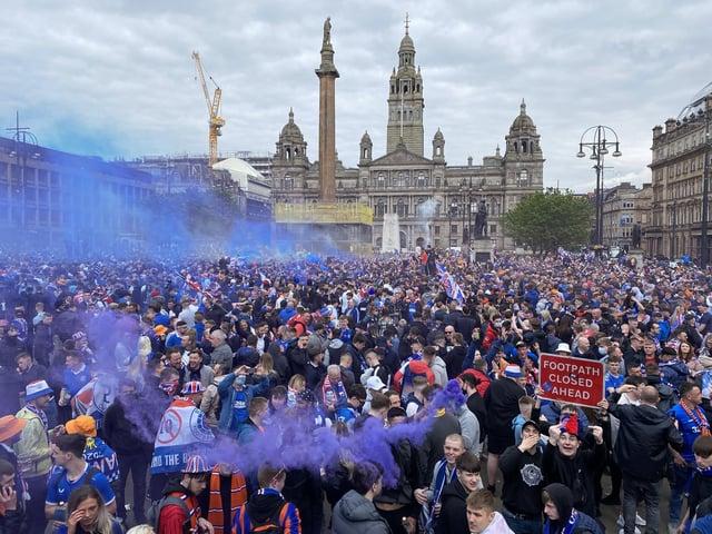 Rangers fans celebrate winning the Scottish Premiership title at George Square
