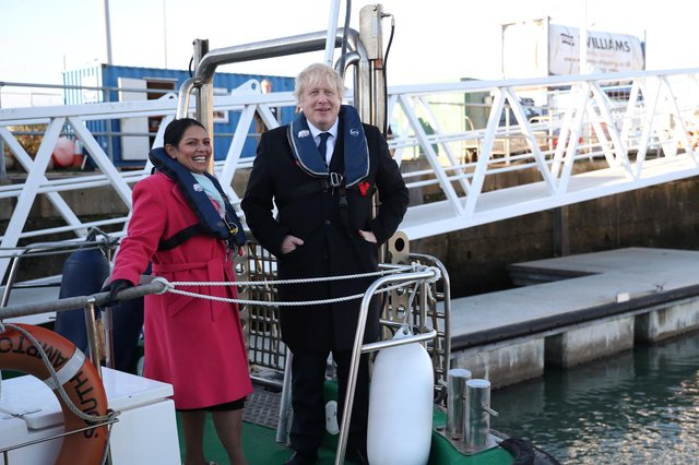 Boris Johnson refused to sack his Home Secretary Priti Patel, seen with the Prime Minister on a security vessel in Southampton port, despite a report concluding she had broken the ministerial code over treatment of civil servants (Picture: Hannah McKay/WPA pool/Getty Images)
