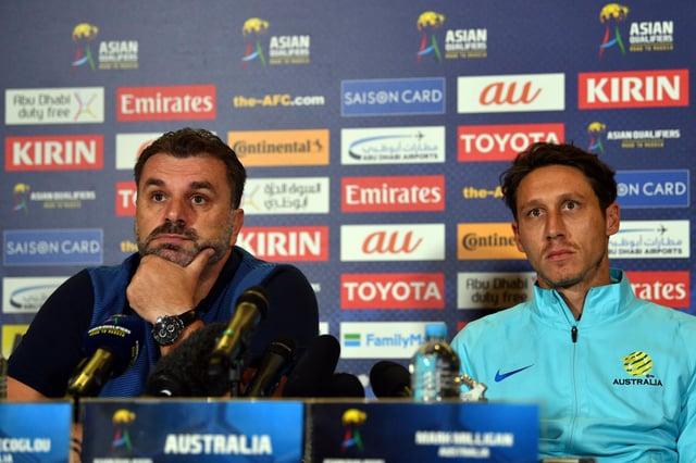 Ange Postecoglou, left, and Mark Milligan speak at an Australia press conference in 2017