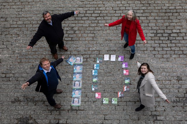Gavin Keddie and Andrew McAllister, of The Wee Book Company, and councillors Mandy Watt and Kate Campbell celebrate the tenth anniversary of the Edinburgh Guarantee scheme as it is expanded to help people of all ages, as well as school leavers, find work or training (Picture: Lloyd Smith)
