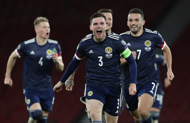 Andy Robertson of Scotland celebrates after his team's victory in the penalty shoot out during the UEFA EURO 2020 Play-Off semi-finals match between Scotland and Israel at Hampden Park on October 08, 2020 in Glasgow, Scotland. (Photo by Ian MacNicol/Getty Images)