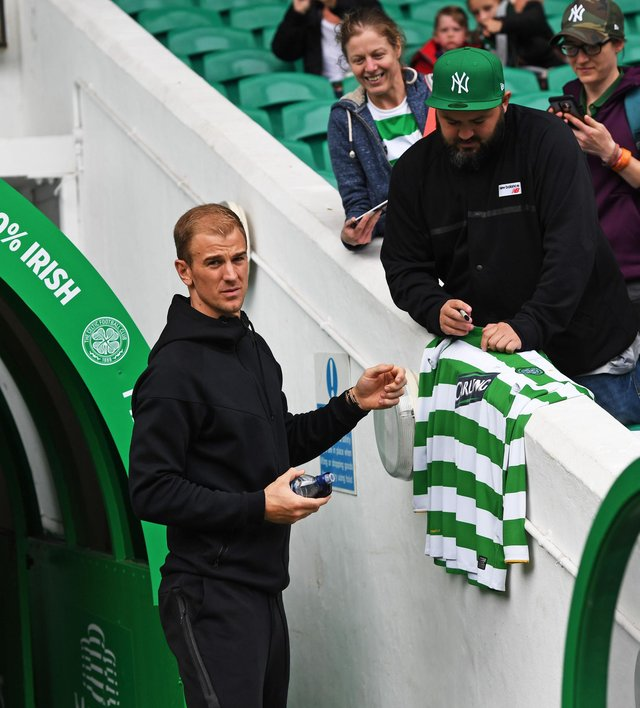 Joe Hart signs an autograph at Celtic Park when there for the Milner/Petrov match for cancer three years ago. Now a player at the Parkhead club, he says he knows from Fraser Forster's experience that, when all is going well,