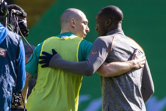 Celtic captain Scott Brown (left) embrace Rangers' Glen Kamara pre match during the Scottish Premiership match between Celtic and Rangers at Celtic Park, on March 21, 2021, in Glasgow, Scotland. (Photo by Craig Williamson / SNS Group)