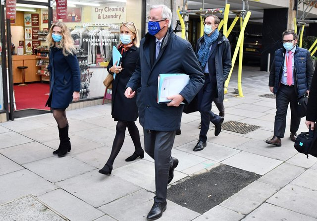 EU chief Brexit negotiator Michel Barnier, wearing an EU flag-themed facemask due to the novel coronavirus pandemic, leaves a hotel in London. Picture: Justin Tallis/AFP via Getty Images