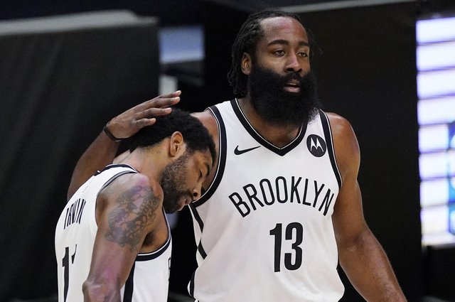 Brooklyn Nets guard Kyrie Irving, left, gets a pat on the head from guard James Harden. Picture: Mark J. Terrill/AP
