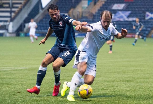 Raith's Reghan Tumilty and Dundee's Paul McGowan in action during the Scottish Premiership play-off match between Raith Rovers and Dundee at Stark's Park on May 12, 2021, in Kirkcaldy, Scotland. (Photo by Euan Cherry / SNS Group)