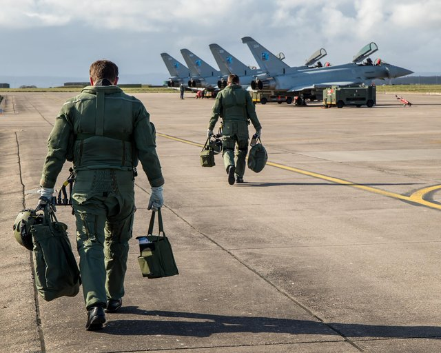 Pilots heading for four Royal Air Force Typhoons from 6 Sqn RAF Lossiemouth in April 2020. Picture: PA Media
