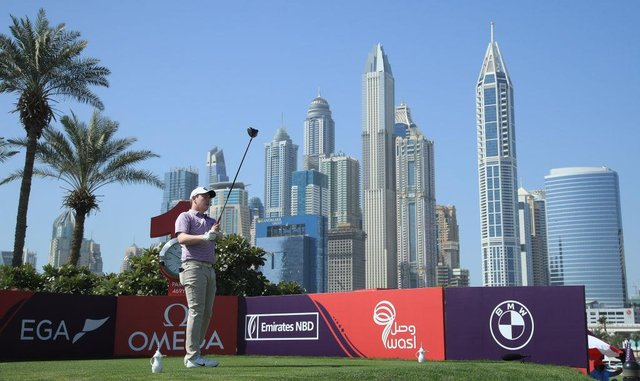 Bob MacIntyre hits his tee-shot on the first hole in the third round of the Omega Dubai Desert Classic at Emirates Golf Club. Picture: Andrew Redington/Getty Images.