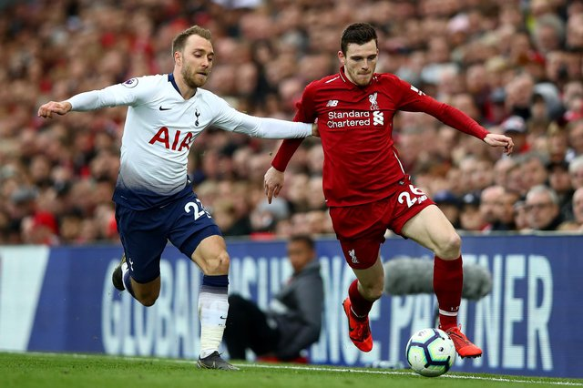 Former Tottenham midfielder Christian Eriksen and Liverpool's Andrew Robertson in action during a Premier League match in 2019. (Photo by Clive Brunskill/Getty Images)