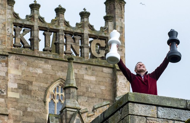 Scottish Liberal Democrat Leader Willie Rennie frolics at Dunfermline Abbey, where he announced his party's plans to raise the starting age for formal schooling