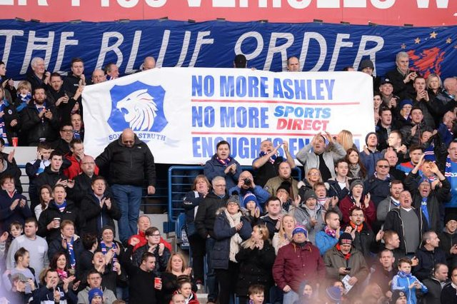 Rangers supporters display their opposition to Mike Ashley's involvement in the club during a match at Ibrox in March 2016. (Photo by Rob Casey/SNS Group).