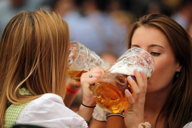 Women drink beer during the 2019 Oktoberfest in Munich (Picture: Johannes Simon/Getty Images)