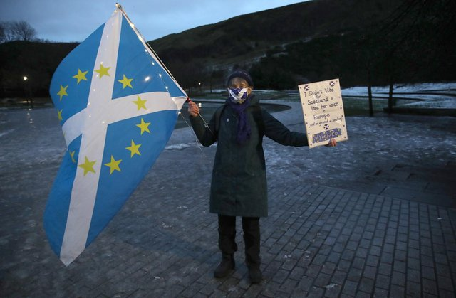 Supporters of the campaign group Yes for EU outside the Scottish Parliament at Holyrood in Edinburgh as they protest against Brexit