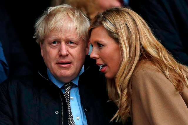 Could this be the moment Carrie Symonds told Boris Johnson how much the new Downing Street wallpaper is going to cost?  (Photo: Adrian Dennis / AFP via Getty Images)