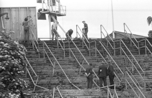 June 1971 - workmen clear the barricades from stairway 13 at Ibrox football stadium, scene of the Ibrox Disaster in February 1971