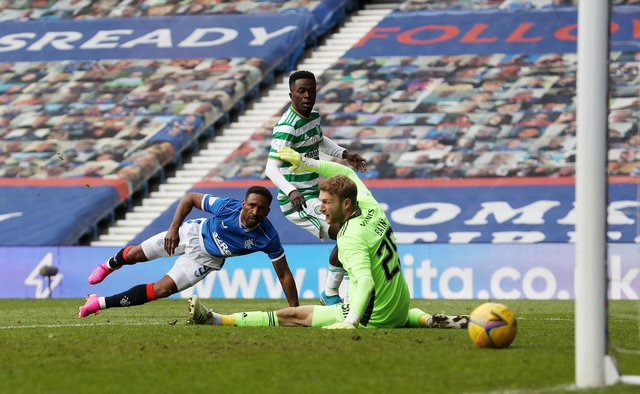 Jermain Defoe finishes off a fine individual goal to complete the scoring in Rangers' 4-1 win over Celtic at Ibrox on May 2. (Photo by Ian MacNicol/Getty Images)