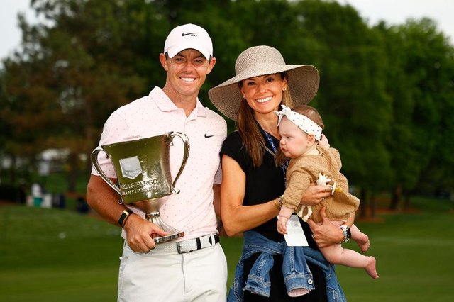 Rory McIlroy celebrates with the trophy alongside his wife Erica and daughter Poppy after winning the 2021 Wells Fargo Championship at Quail Hollow Club in Charlotte, North Carolina. Picture: Jared C. Tilton/Getty Images.