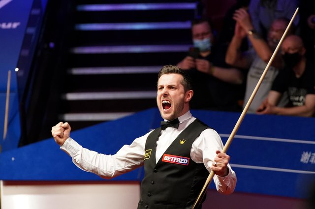 Mark Selby celebrates his victory over Shaun Murphy.