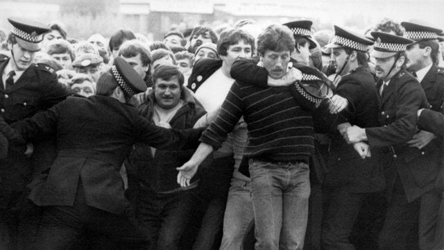 Police restrain picketers outside a pit during the miners' strike in the 1980s.